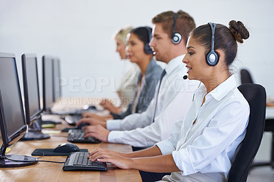 Buy stock photo Shot of a client services team fielding phonecalls