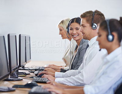 Buy stock photo Portrait of an attractive young woman working in a client services team
