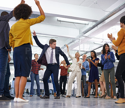 Buy stock photo Shot of a businessmen dancing in the centre of a circle of coworkers