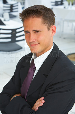 Buy stock photo Portrait of a young businessman with his arms crossed