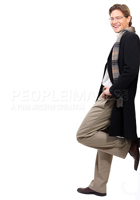 Buy stock photo Cheerful businessman leaning against white background