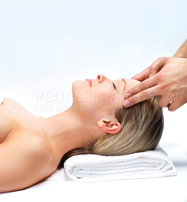 Buy stock photo Facial Massage at the day spa. Portrait of a pretty young girl getting a massage at the day spa