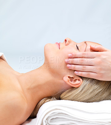 Buy stock photo Hands massaging female face at the spa - Beautiful woman relaxing with a head massage at the beauty spa.