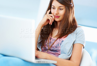 Buy stock photo Pretty young girl sitting on chair using laptop