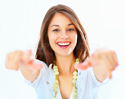 Buy stock photo Portrait of beautiful young girl pointing at you with both hands over white background