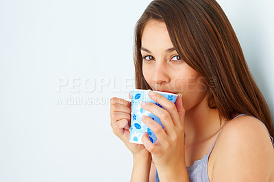 Buy stock photo Closeup of beautiful girl drinking cup of coffee and looking at you