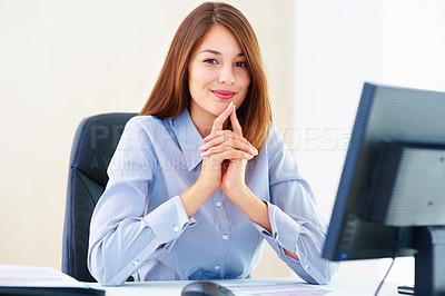 Buy stock photo Portrait of young businesswoman sitting in office and giving you cute smile