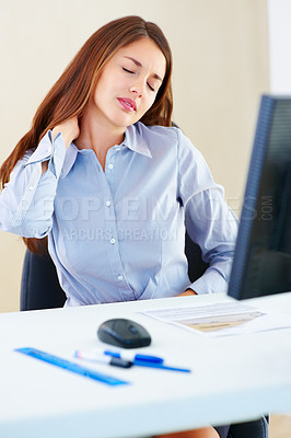 Buy stock photo Young female executive holding her neck in pain