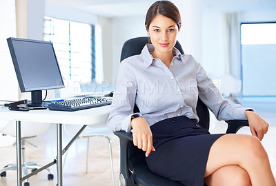 Buy stock photo Portrait of young businesswoman sitting in an office chair and smiling