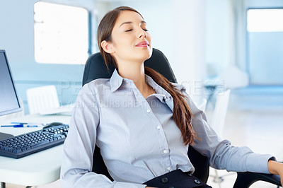 Buy stock photo Young businesswoman resting in an office chair
