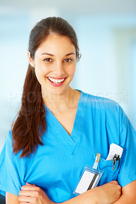Buy stock photo Portrait of beautiful young doctor standing with hands folded and smiling