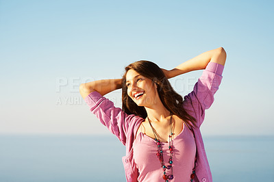 Buy stock photo Portrait of attractive young woman with hands behind head - copyspace