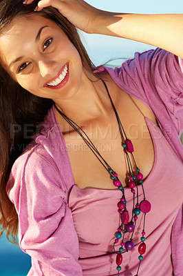 Buy stock photo Attractive young woman with hand in hair smiling
