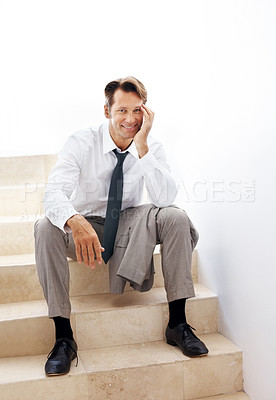 Buy stock photo Portrait of smiling young business man sitting on staircase