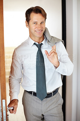 Buy stock photo Portrait of happy young businessman standing near by the door