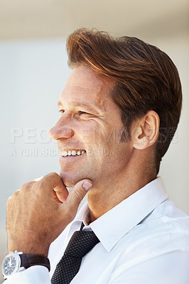 Buy stock photo Portrait of a smiling young businessman looking away with his hand on chin