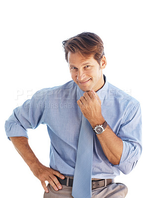 Buy stock photo Portrait of a confident young businessman posing with his hand on chin against white