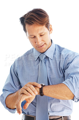 Buy stock photo Portrait of a successsul young businessman checking time against white background