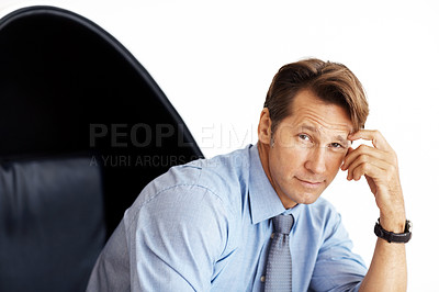 Buy stock photo Portrait of a handsome young male executive sitting on chair