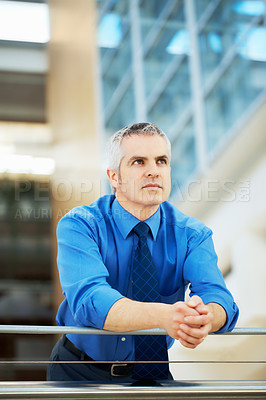 Buy stock photo Serious executive standing with hands clasped