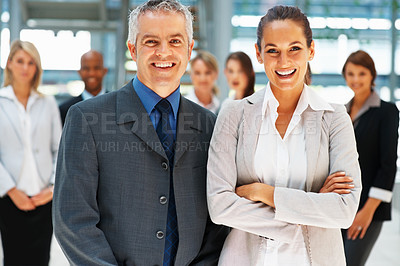 Buy stock photo Friendly team with colleagues in background