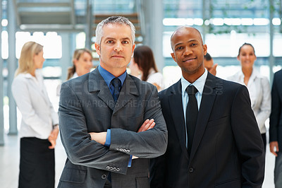 Buy stock photo Team of executives with colleagues in background