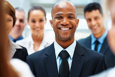Buy stock photo Closeup of happy businessman with team in background