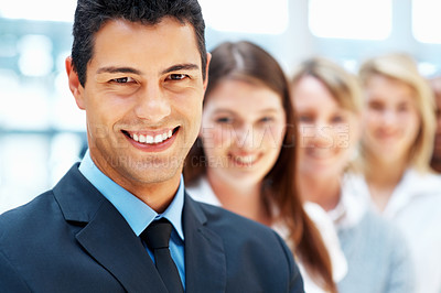 Buy stock photo Focus on businessman with colleagues standing behind him