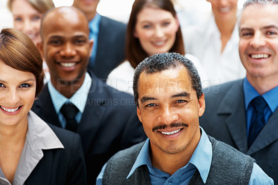 Buy stock photo Focus on businessman with colleagues behind him