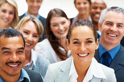 Buy stock photo Pretty business woman smiling with colleagues around her