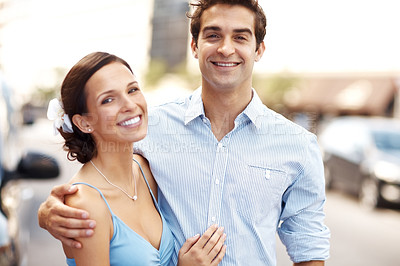 Buy stock photo Portrait of romantic young couple smiling together outdoor