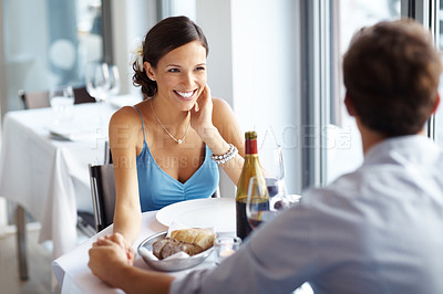 Buy stock photo Gorgeous young woman smiling while sitting together with her boyfriend at a cafe
