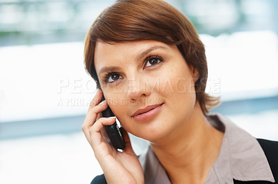 Buy stock photo Closeup of pretty young executive using cell phone