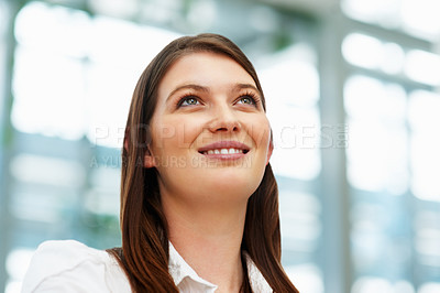 Buy stock photo Young business woman looking into distance and smiling
