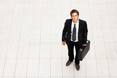 Buy stock photo High angle view of handsome business man with briefcase
