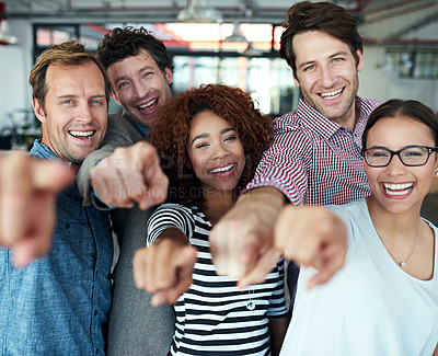 Buy stock photo Portrait of a group of office colleagues pointing at the camera