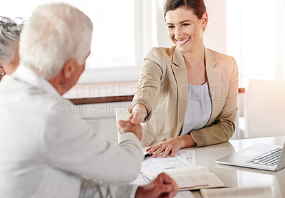 Buy stock photo Cropped shot of a senior couple meeting with their financial consultant