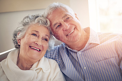 Buy stock photo Cropped shot of a senior couple looking thoughtful at home