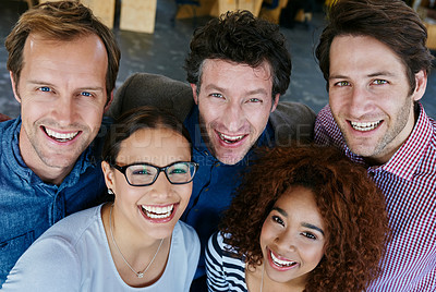 Buy stock photo Closeup portrait of a group of estatic coworkers standing in an office