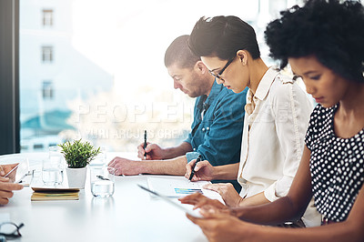 Buy stock photo Shot of a group of colleagues working in an office