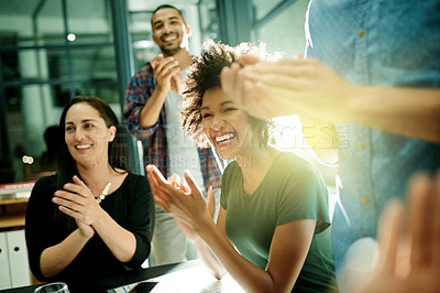 Buy stock photo Shot of a team of creative businesspeople applauding an achievement  while working late in the boardroom