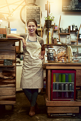 Buy stock photo Portrait of a happy young woman working in a coffee shop