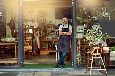 Buy stock photo Portrait of a confident young man standing in the doorway of a coffee shop