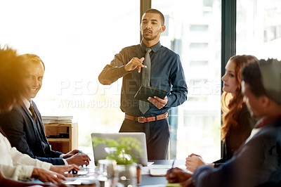 Buy stock photo Cropped shot of a group of executives having a boardroom meeting together
