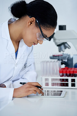 Buy stock photo Cropped shot of an attractive young female scientist working in her lab
