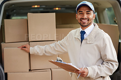 Buy stock photo Portrait of a friendly delivery man standing next to a van full of boxes
