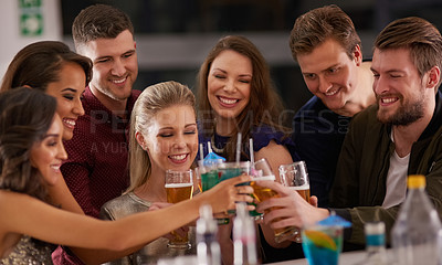 Buy stock photo Shot of a happy group of friends having drinks at a bar together
