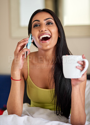 Buy stock photo Shot of a happy young woman talking on the phone in bed