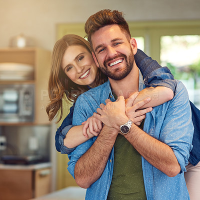 Buy stock photo Portrait of a happy young couple embracing at home
