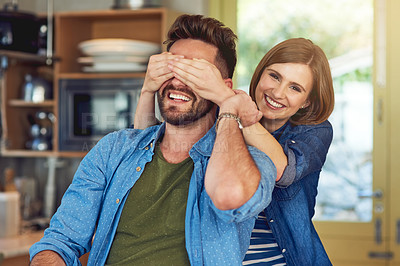 Buy stock photo Portrait of a happy young woman playfully covering her husband's eyes